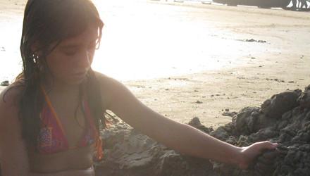 girl sun sandcastle