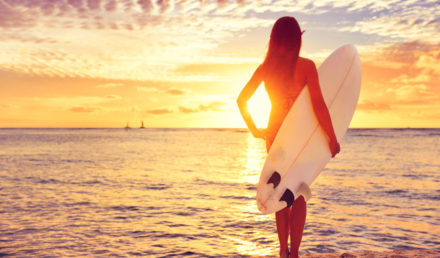 wellness-surfer-girl-surfing-looking-at-85475813