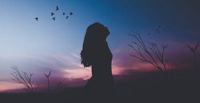 Wellness-Resilience-Resilient woman-dark-sky